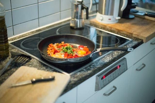 Cook top with peppers in a sauce pan.