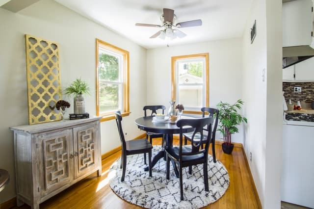 Declutter your life: small, round, black table with four chairs, dining room