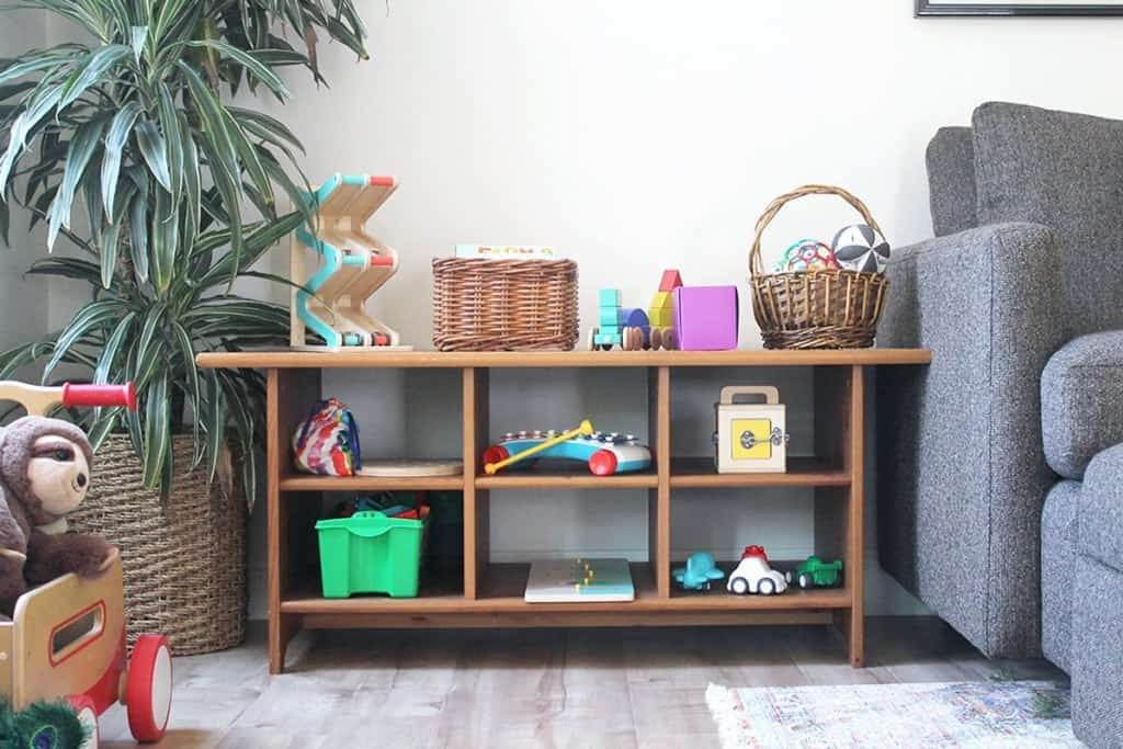 Kait used a coffee table with cubbies for toy storage.