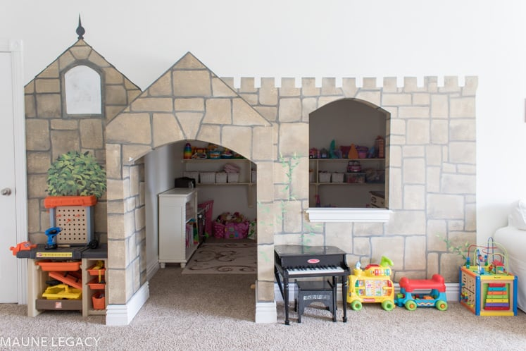 Jennifer said the secret play room and castle mural was definitely a bonus feature when they bought their house. | Playroom organization
