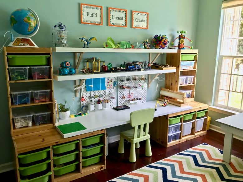 Ashley turned their playroom into a dream MAKERSPACE complete with storage bins, a desk for making creations and shelves to display the final LEGO creations. | Playroom storage