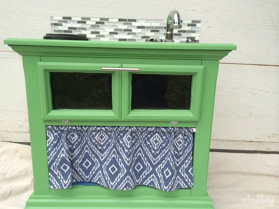 Jenny turned a night stand into a play kitchen. | DIY Play Kitchen