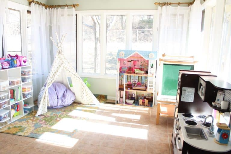 Erica set up a teepee in the corner to create an intimate space for her kids to play and used clear bins as toy storage.