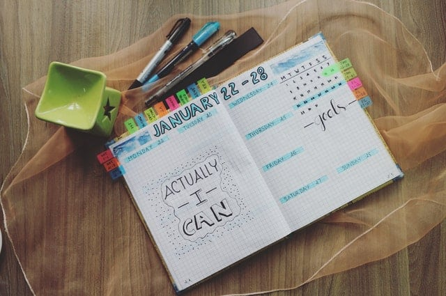 Picture of a planner with pens and markers. -- Time management for moms