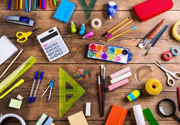 An array of arts and crafts supplies laid out on a wooden table. -- easy activities for kids