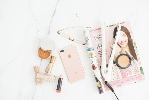 Collection of makeup, phone, glasses and beauty magazine. | time blocking for moms