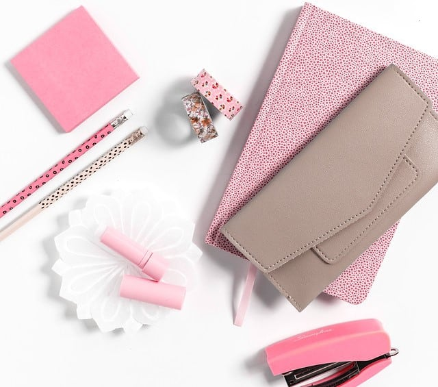 Pink planner, wallet, lip gloss, stapler and other office supplies. | time blocking for moms