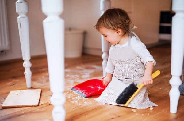 Little girl sweeping up flour off the floor. | sticker chore chart