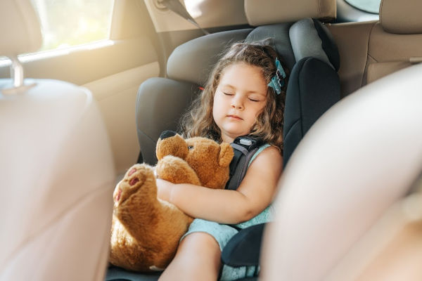 4 year old girl sleeping in her carseat while hugging her teddy bear. | clean car with kids