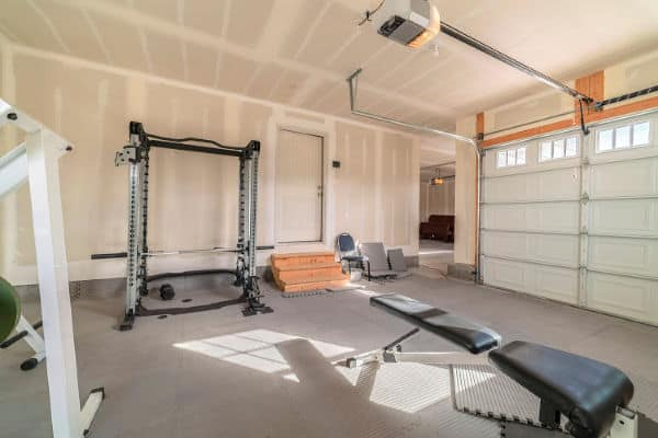 Home gym set up in a clutterfree garage.