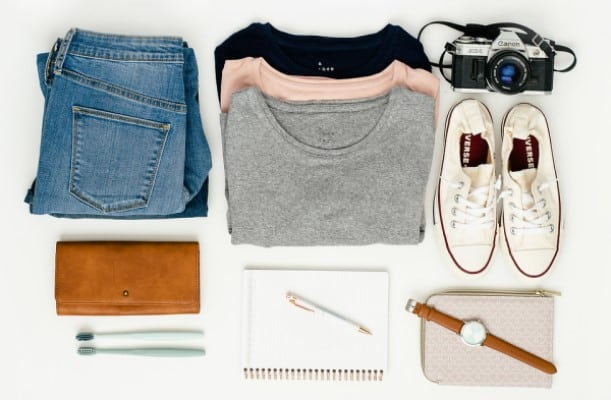 Neatly arranged and folded clothes, shoes, notepad, wallet, watch and camera. | motivation to declutter
