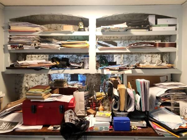 My extremely messy wet bar, covered in papers, a tool box, notebooks and ukulele.   overwhelmed by a messy house