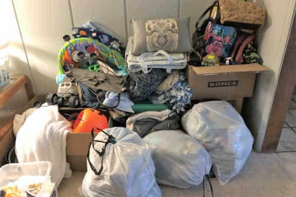A giant pile of boxes and bags of stacked donations. -- clutter solutions
